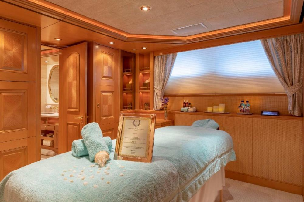 LAUREL - Luxury Motor Yacht For Charter - 7th stateroom can serve as a massage / spa room (upon request) or as a staff/security room with a Murphy style Queen size bed and/or Twin bed inclusive of ensuite head with Jacuzzi tub/shower - Img 1 | C&N